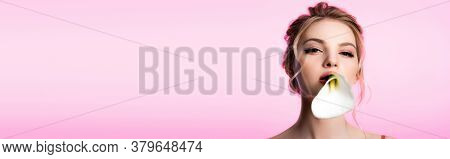 Beautiful Blonde Woman Holding Calla Flower In Mouth Isolated On Pink, Panoramic Shot