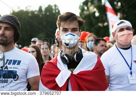 Minsk/belarus - July 30, 2020: Portrait Of Young Man In Face Mask And Flag At Opposition Rally In Mi