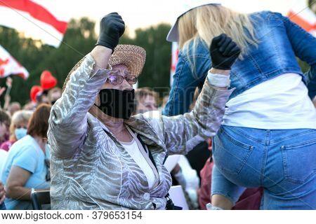 Minsk, Belarus - July 30, 2020: Elderly Woman In Face Mask Is Dancing At Opposition Rally In Minsk O