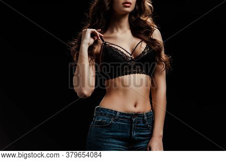 Cropped View Of Young Woman Touching Lace Bra Isolated On Black Background