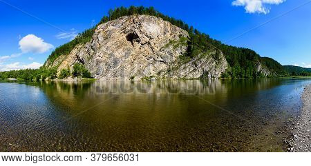 Beautiful Landscape Of The Calm River With Coastal Cliffs And Coniferous Forest, Reflected In The Wa