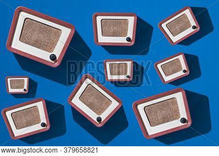 Background Of Retro Radios On A Blue Background. Old Radio Equipment.