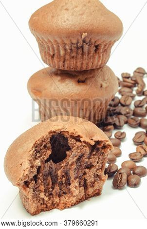 Fresh Baked Homemade Muffins And Coffee Grains On White Background. Delicious Dessert Concept