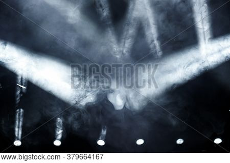 Ray Of Light With Smoke And Fog Spotlights On The Stage. Scene Light Equipment