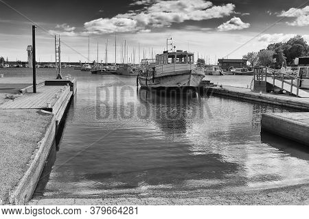 An Old Wooden Boat Is Waiting For Passangers At The Harbour Of Kotka In Finland. These Boats Used To