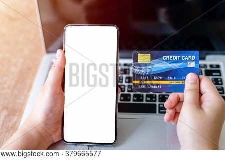 Close-up Of Freelance People Business Female Hand Holding Credit Cards Casual And Smartphone Working