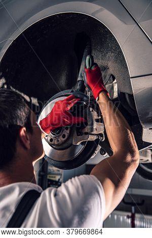 Mechanic Repairing The Bearing In The Car Repair Shop
