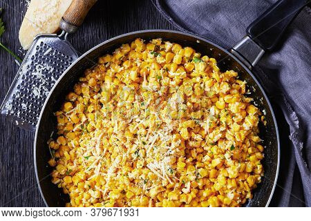 Parmesan Cilantro Corn In A Skillet On A Dark Wooden Table With Grey Cloth, Parmesan Cheese And Grat