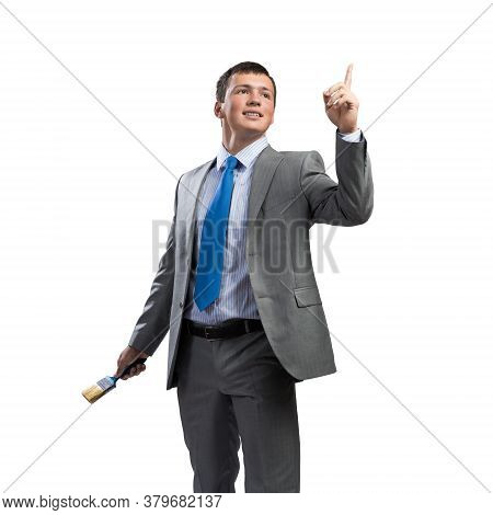 Confident And Creative Businessman Painter Finger Pointing Upwards. Portrait Of Happy Handsome Man I