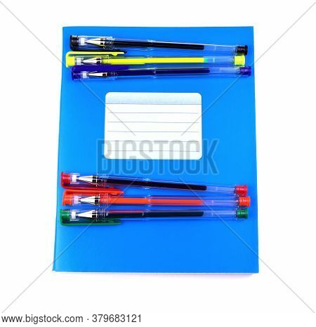 Blue Notebook And Colorful Gel Pens. School Education. Copy Space. Place For Text.