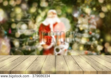 Wood Table Top On Blurred Colorful Christmas Tree And Bokeh Background, For Display Or Montage Produ