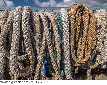Old mooring lines hung to dry in the harbour