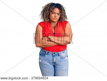 Young african american plus size woman wearing casual style with sleeveless shirt skeptic and nervous, disapproving expression on face with crossed arms. negative person.