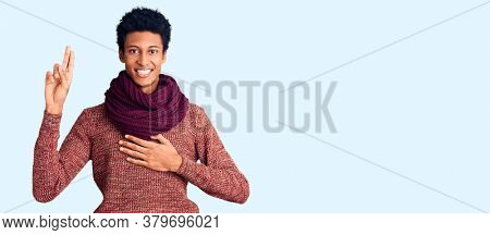Young african american man wearing casual winter sweater and scarf smiling swearing with hand on chest and fingers up, making a loyalty promise oath