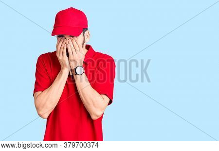Young handsome man with beard wearing delivery uniform rubbing eyes for fatigue and headache, sleepy and tired expression. vision problem