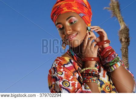 Portrait Of A Young And Attractive African American Black Woman Softly Smiling In The National Afric