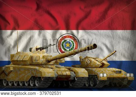 Tanks With Orange Camouflage On The Paraguay Flag Background. Paraguay Tank Forces Concept. 3d Illus