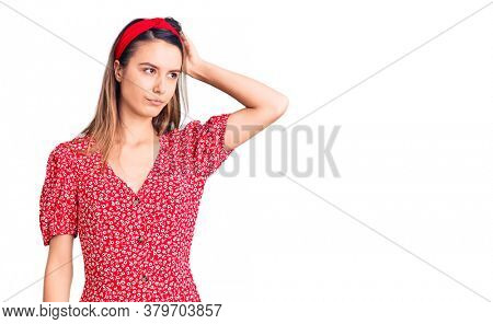 Young beautiful girl wearing dress and diadem confuse and wondering about question. uncertain with doubt, thinking with hand on head. pensive concept.