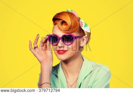 Sunglasses. Portrait Of Cute Young Pinup Girl Woman With Retro 50s Vintage Hair Style Holding Showin
