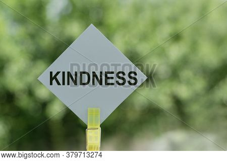 Kindness Text On Paper With Clothespins With Bokeh On Background. The Word Kindness. Kindness Concep