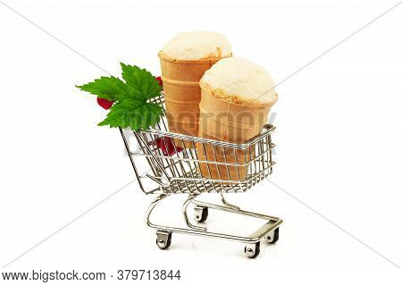 Two Tasty Milky Ice Cream In Waffle With Fresh Green Leaf In Metallic Shopping Trolley Isolated On W