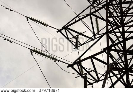 Silhouette Of Electricity Post. High-voltage Electric Pylon,high Voltage Power Supply In Cloudy Day.