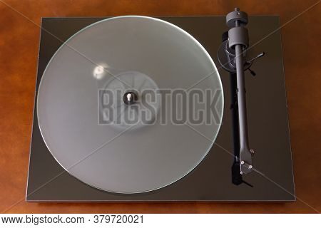 Black Vinyl Record Player. Vinyl Record Player With A Frosted Glass Disc. Top View.