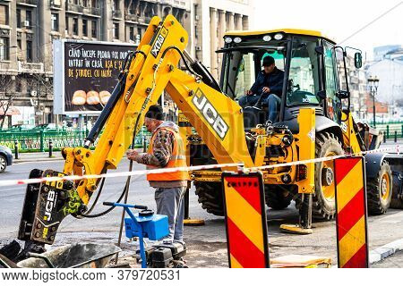 Yellow Backhoe Loader On Construction Site Ready For Working In Bucharest, Romania, 2020
