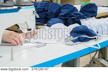 Covid-19, Close Up Of Sewing Process On The Overlock In The Sewing Shop. Tailoring Industry.. Interi