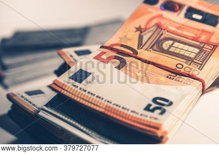Stack Of Bundles Of Fifty Euro Currency Banknotes In Close Up View.