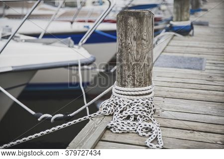 Wooden Post For Mooring Yachts On The Pier In Denmark