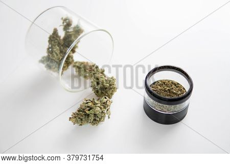 Cannabis Buds In Grinder. Marijuana Nature Bud. The Sugar Pot Leaves On Buds. White Background