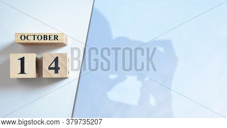October 14, Shadow Of Photographer With Number Cube.