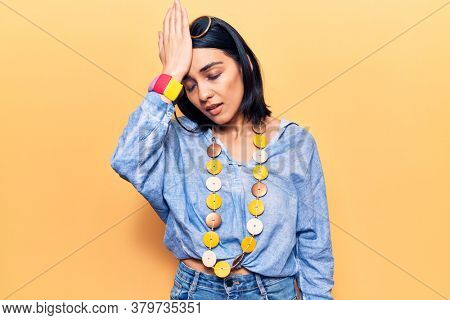 Young beautiful latin woman wearing casual clothes surprised with hand on head for mistake, remember error. forgot, bad memory concept.