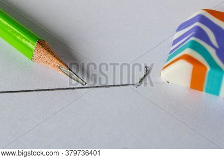 Colorful Eraser And Simple Pencils On A Light Background. Close Up. Selective Focus