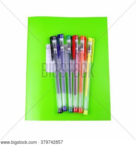 Green Notebook And Colorful Gel Pens. School Education. Copy Space. Place For Text.