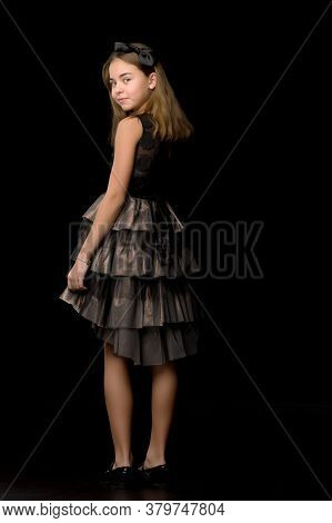 Beautiful Teenage Girl, Studio Photo. The Concept Of Fashion And Style. On A Black Background.