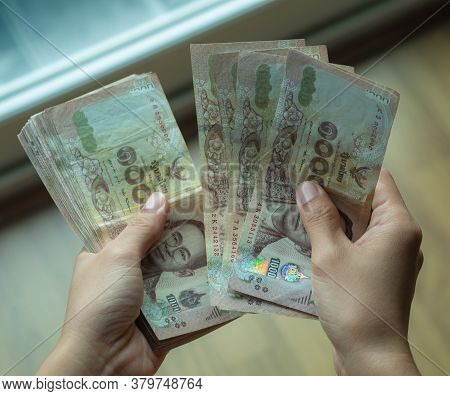 Hands Holding Thai Money, Kind Of Thousand Thai Baht.