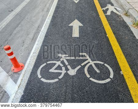 New Urban Transport Bikeway With Yellow Separation Line Next To An Asphalt Road. Traffic Only Allowe