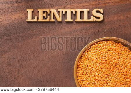 Lens Culinaris - Raw Lentils. Title In Wooden Letters