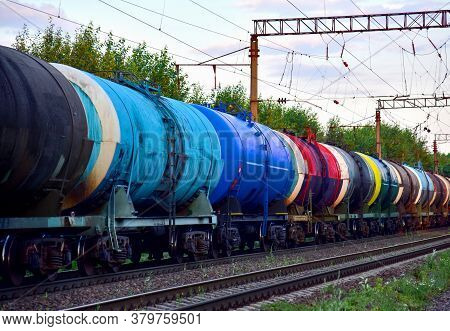 Freight Train With Petroleum Tank Cars On Railroad. Rail Cars Carry Oil And Ethanol. Railway Logisti