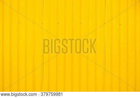Yellow Metal Tile Fence Background. Fence From Corrugated Board. Yellow Slate Background. Yellow Zin