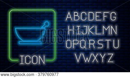 Glowing Neon Mortar And Pestle Icon Isolated On Brick Wall Background. Neon Light Alphabet. Vector I