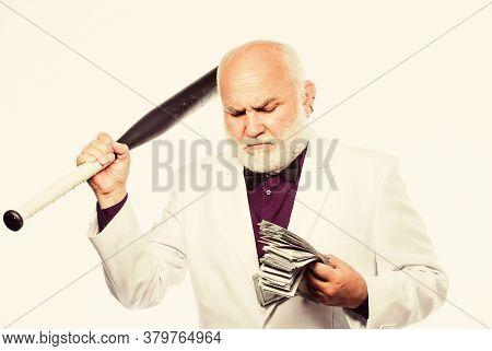 Racket And Raiding. Kingpin Concept. Black Cash Money. Senior Man Hold Cash Money And Baseball Bat.