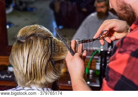 Designing Haircut. Barber Tools In Barbershop. Handsome Hairdresser Cutting Hair Of Male Client. Hai