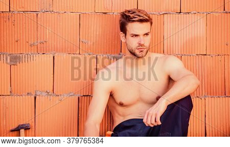 Macho Man. Worker Brick Wall Background. Building Skills And Construction. Professional Repairman. T