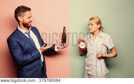 Want Some. Man Alcoholic Drink Wine. Woman Show Time On Alarm Clock. Wife Wondering Why Husband Reve