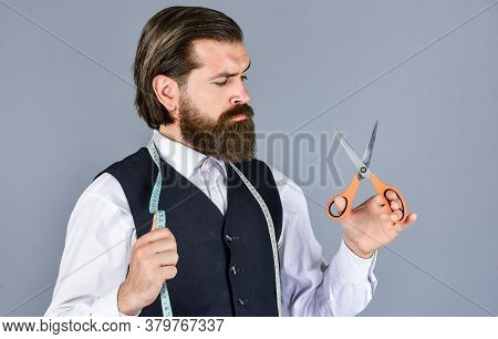 Formal And Office Style. Man Tailor With Tape Measure And Scissors. Man Tailoring Clothes. Brutal Ma