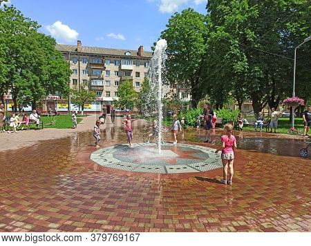 Chernihiv / Ukraine. 02 July 2020:  Children Have A Fun With City Fountains During Summer Heat. Chil