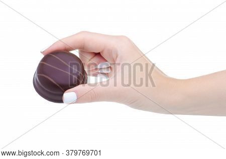 Chocolates With Souffle In Hand On A White Background Isolation